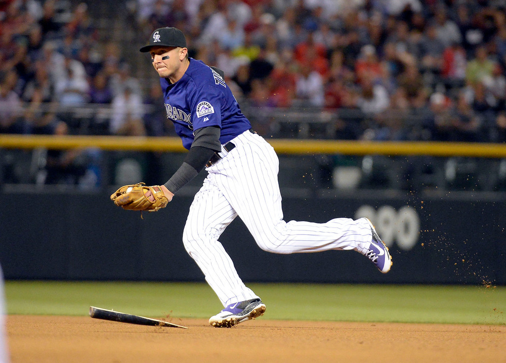 . DENVER, CO. - SEPTEMBER 24: Troy Tulowitzki (2) of the Colorado Rockies avoids the broken bat of David Ortiz (34) of the Boston Red Sox as he runs over to tag out Dustin Pedroia of the Boston Red Sox for the out September 24, 2013 at Coors Field. (Photo by John Leyba/The Denver Post)