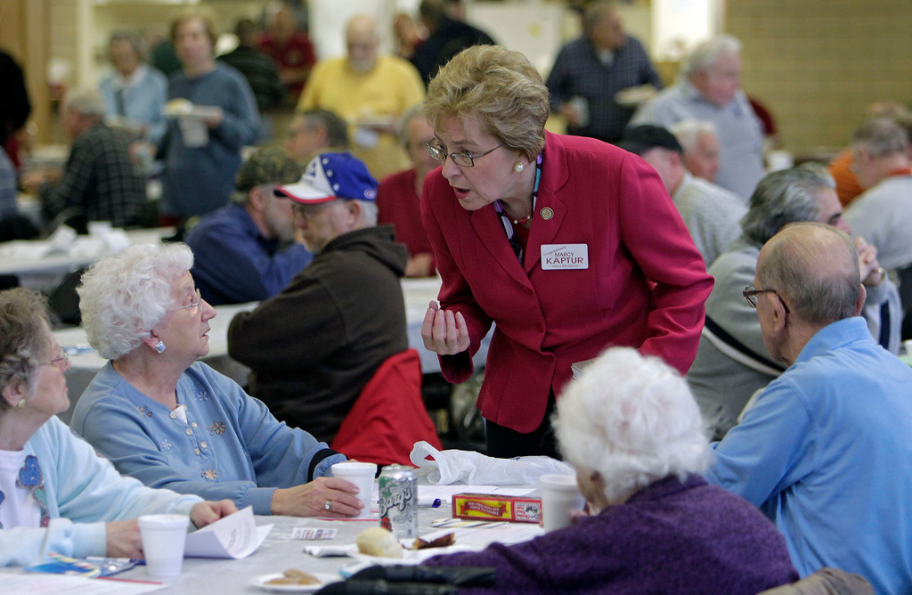 . U.S. Rep. Marcy Kaptur, D-Ohio, talks with retired autoworkers at UAW Local 1005\'s monthly retirees lunch in Parma Thursday, Jan. 26, 2012. Redistricting has pitted the Toledo Democrat against Cleveland area congressman Dennis Kucinich in the March primary. (AP Photo/Mark Duncan)