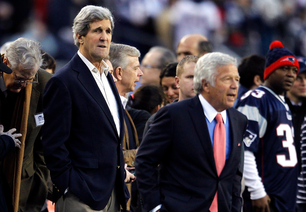 Description of . U.S Senator and Nominee for U.S. Secretary of State John Kerry (L)  (D-Massachusetts) stands on the sidelines with New England Patriots owner Robert Kraft before the NFL AFC Divisional playoff football game between the Patriots and the Houston Texans in Foxborough, Massachusets January 13, 2013. REUTERS/Jessica Rinaldi