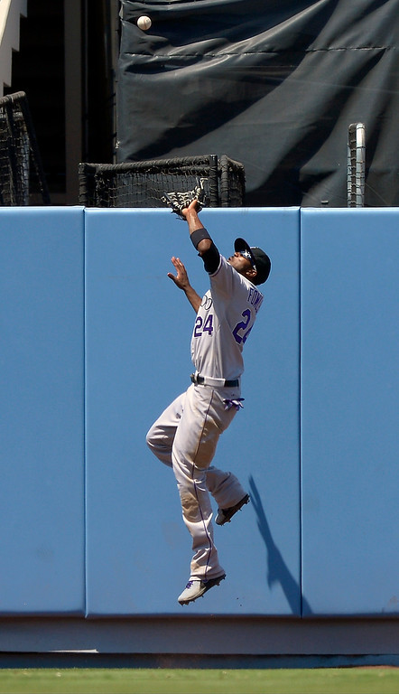 . Colorado Rockies center fielder Dexter Fowler makes a catch on a ball hit by Los Angeles Dodgers\' A.J. Ellis during the fourth inning of a baseball game on Sunday, July 14, 2013, in Los Angeles. (AP Photo/Mark J. Terrill)