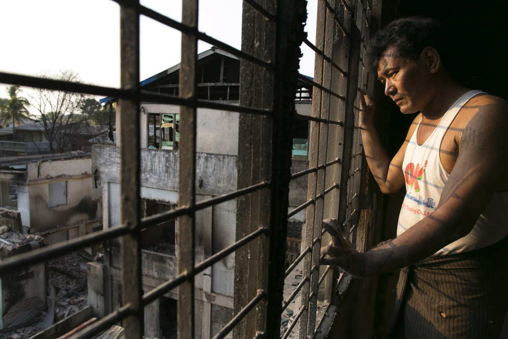 . U Tun Win looks out from his burned guest house on April 5, 2013 in Meiktila, Myanmar.  Recent sectarian violence between Buddhists and Muslims in March left 43 people dead, with large areas of the town completely destroyed by fires and looting, while many were injured with thousands of Muslims now homeless. Many Muslims who had money fled as the violence began to spin out of control while the remaining people are being kept in well policed IDP camps in the town.  (Photo by Paula Bronstein/Getty Images)