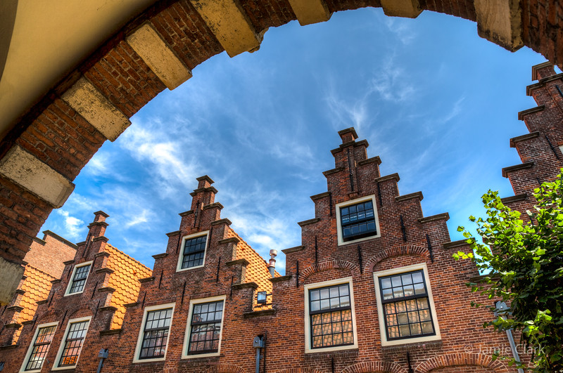 Typical Ducth rooftops. We were wondering if the number of steps have significance. Haarlem.