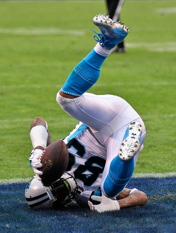. Carolina Panthers wide receiver Steve Smith tumbles into the end zone with a touchdown reception against the San Diego Chargers during the second half of a NFL football game Sunday, Dec. 16, 2012, in San Diego. (AP Photo/Denis Poroy)