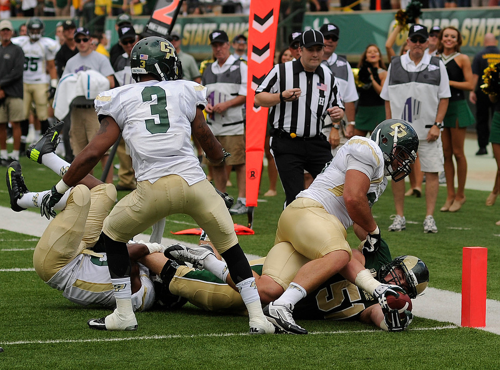 . FORT COLLINS, CO. - SEPTEMBER 14: CSU lineman Ty Sambrailo (51) reached the ball across the goal line in the second quarter. Officials ruled that he was already down. The Rams scored on the next play anyway. The Colorado State University football team hosted Cal Poly at Hughes Stadium in Fort Collins Saturday afternoon, September 14, 2013.  Photo By Karl Gehring/The Denver Post