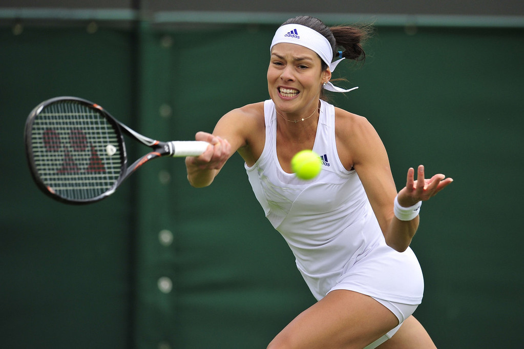 . Serbia\'s Ana Ivanovic returns on her way to beating France\'s Virginie Razzano during their first round match on day one of the 2013 Wimbledon Championships tennis tournament at the All England Club in Wimbledon, southwest London, on June 24, 2013. Ivanovic won 7-6, 6-0.  GLYN KIRK/AFP/Getty Images