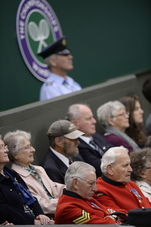 . Chelsea Pensioners watch the action as Czech Republic\'s Petra Kvitova plays against Belgium\'s Kirsten Flipkens during their women\'s singles quarter-final match on day eight of the 2013 Wimbledon Championships tennis tournament at the All England Club in Wimbledon, southwest London, on July 2, 2013. ADRIAN DENNIS/AFP/Getty Images