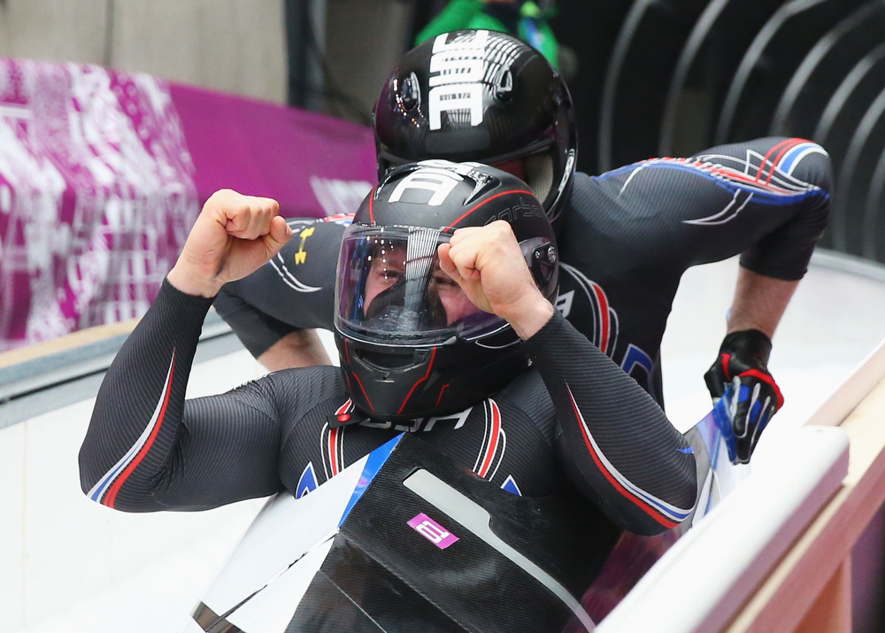 . Pilot Steven Holcomb and Steven Langton of the United States team 1 celebrate after a run during the Men\'s Two-Man Bobsleigh on Day 10 of the Sochi 2014 Winter Olympics at Sliding Center Sanki on February 17, 2014 in Sochi, Russia.  (Photo by Alex Livesey/Getty Images)