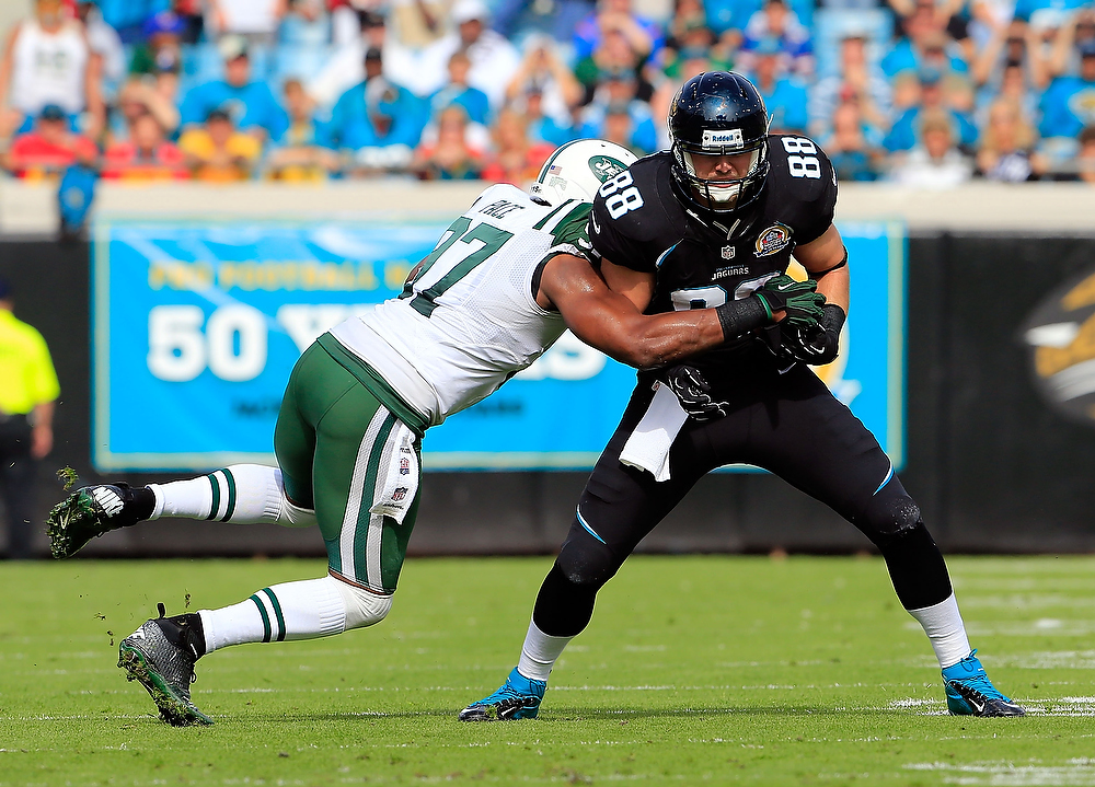 . JACKSONVILLE, FL - DECEMBER 09:   Kevin Elliott #87 of the Jacksonville Jaguars is tackled by  Calvin Pace #97 of the New York Jets during the game at EverBank Field on December 9, 2012 in Jacksonville, Florida.  (Photo by Sam Greenwood/Getty Images)