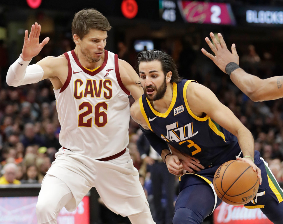 . Utah Jazz\'s Ricky Rubio (3), from Spain, drives against Cleveland Cavaliers\' Kyle Korver (26) in the first half of an NBA basketball game, Saturday, Dec. 16, 2017, in Cleveland. (AP Photo/Tony Dejak)