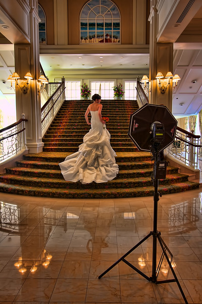 Photographer in action shooting a bride.jpg
