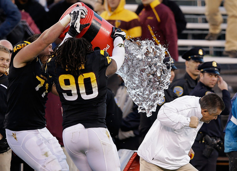 . Head coach Todd Graham of the Arizona State Sun Devils is dumped with water by Will Sutton #90 of the Arizona State Sun Devils after they beat the Navy Midshipmen in the Kraft Fight Hunger Bowl at AT&T Park on December 29, 2012 in San Francisco, California.  (Photo by Ezra Shaw/Getty Images)