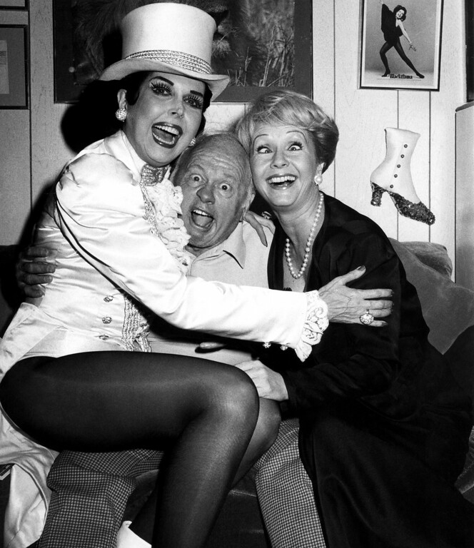 ". Actress Debbie Reynolds, right, clowns around with ""Sugar Babies\"" stars Ann Miller, left, and Mickey Rooney backstage at New York\'s Mark Hellinger Theatre , Sept. 3, 1980. Miss Reynolds will star as the French author Colette in an upcoming Broadway musical \""Door-Ways.\"" (AP Photo/Steve Sands)"