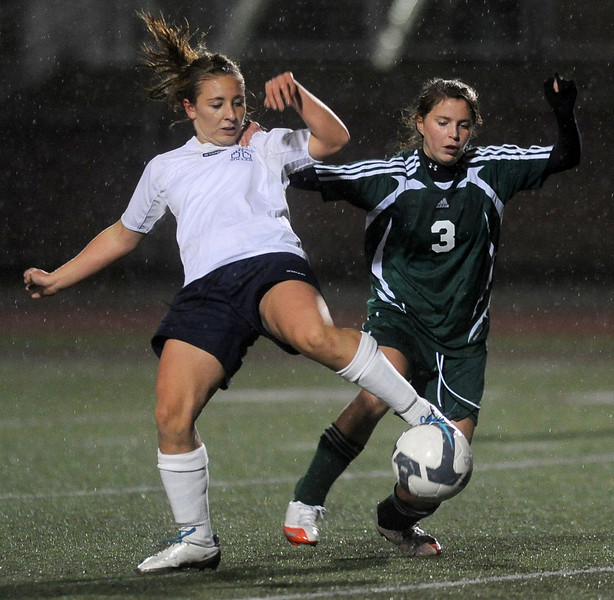 Bellarmine Prep's Stephanie Hamilton, left, and Woodinville's Haley Fay fight for the ball in the first half at Mount Tahoma Tuesday, Nov. 9, 2010. Joe Barrentine/Staff photographer