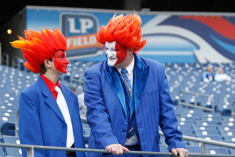 """. Tennessee Titans\' \""""flamehead\"""" fans Zachary Key and his father Jimmy Key wait for kickoff before their NFL football game against the Houston Texans  in Nashville, Tennessee December 2, 2012. REUTERS/Harrison McClary"""