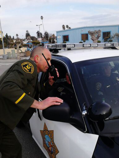 . Santa Cruz County sheriff\'s Lt. Steve Carney helps direct law enforcement ahead of Thursday\'s motorcade in honor of fall Santa Cruz police Sgt. Loran \'Butch\' Baker and Detective Elizabeth Butler on Thursday, March 7, 2013, in Santa Cruz, Calif. (Cathy Kelly/Santa Cruz Sentinel)