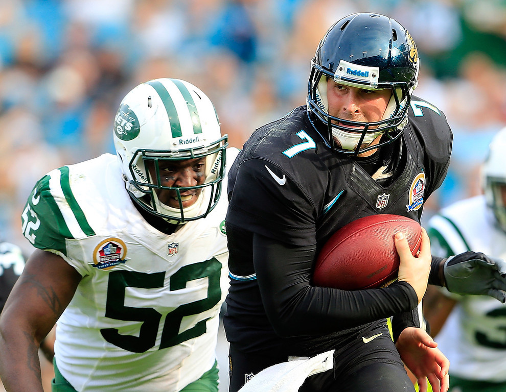 . JACKSONVILLE, FL - DECEMBER 09:   Chad Henne #7 of the Jacksonville Jaguars is pressured by  David Harris #52 of the New York Jets during the game at EverBank Field on December 9, 2012 in Jacksonville, Florida.  (Photo by Sam Greenwood/Getty Images)