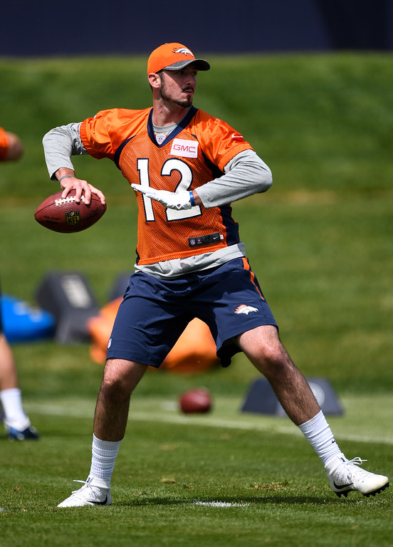 . Denver Broncos quarterback Paxton Lynch (12) looks to throw a pass during rookie minicamp May 6, 2016 at UCHealth Training Facility. (Photo By John Leyba/The Denver Post)