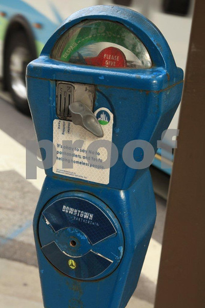 "A parking meter in downtown Baltimore advises people that ""It's okay to say NO to pandhandlers, and YES to homeless people."""