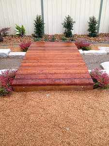 timber bridge and stream bed and sandstone edging