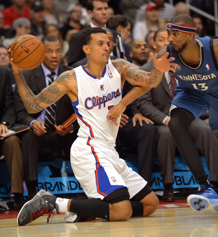 . Los Angeles Clippers\' Matt Barnes recovers a loose ball under pressure from Corey Brewer of the Minnesota Timberwolves Monday, Nov. 11, 2013, in Los Angeles.(Andy Holzman/Los Angeles Daily News)