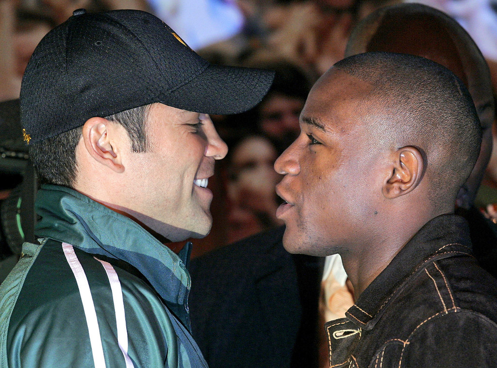 . Boxers Floyd Mayweather Jr., right, and Oscar De La Hoya face off during a news conference at MGM Grand in Las Vegas on Wednesday, May 2, 2007. The pair will fight De La Hoya\'s WBC junior middleweight  boxing title in Las Vegas on Saturday, May 5.  (AP Photo/Jae C. Hong)