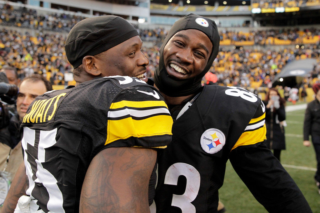 . Pittsburgh Steelers wide receiver Cobi Hamilton, right, celebrates with teammate Arthur Moats (55) after making the winning touchdown catch during overtime of an NFL football game against the Cleveland Browns in Pittsburgh, Sunday, Jan. 1, 2017. (AP Photo/Jared Wickerham)