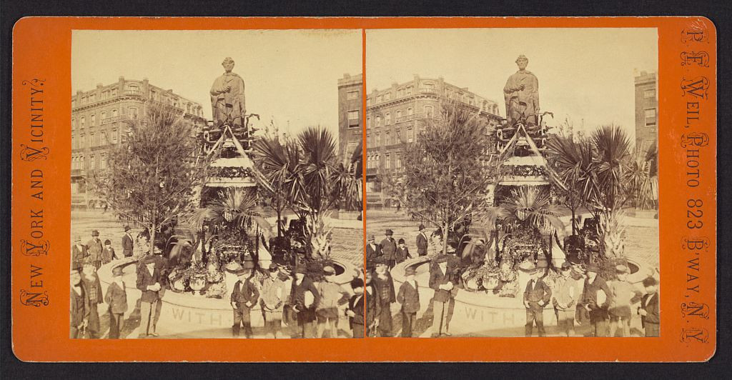. Lincoln Monument, Union Square, Decoration Day, 1876. Stereograph showing a crowd gathered in front of a statue of Abraham Lincoln in Union Square Park which has been decorated for Memorial Day. Peter F. Weil, Photographer. Courtesy the Library of Congress