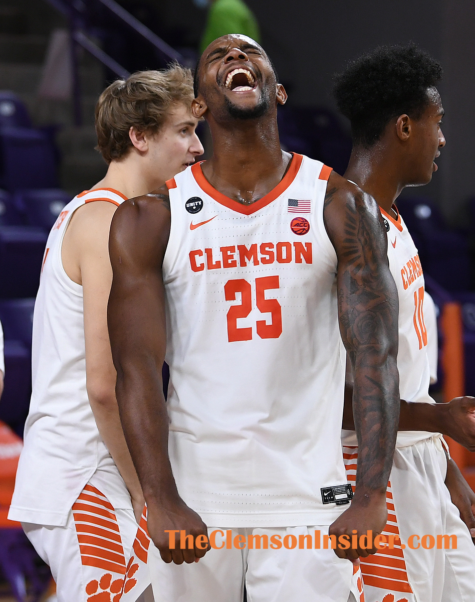 Clemson forward Aamir Simms (25) celebrates the Tigers 78-61 win over Syracuse at Clemson's Littlejohn Coliseum Saturday, February 6, 2021. ACC Pool/Bart Boatwright/The Clemson Insider