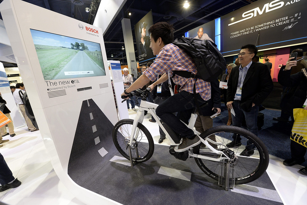 . An attendee rides a bicycle equipped with Bosch sensors and a interactive cycling screen at the Las Vegas Convention Center for the 2014 International CES (Consumer Electronics Show) in Las Vegas, Nevada, USA, 08 January 2014. CES, the world\'s largest annual consumer technology trade show, runs from 7-10 January and is expected to feature 3,200 exhibitors displaying their latest products and services to about 150,000 attendees.  EPA/MICHAEL NELSON