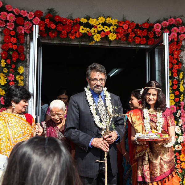 Aunt & uncle of the groom exit the temple during one of the ceremonies at the Vidhi.