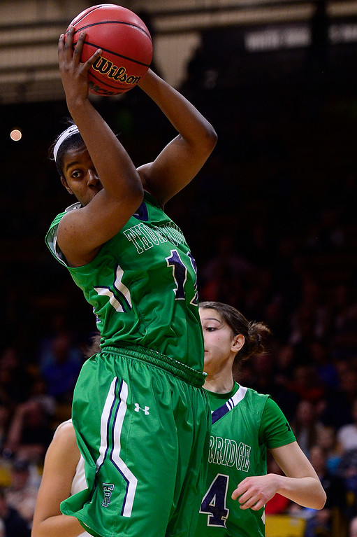 . Jaz\'myne Snipes (12) of ThunderRidge brings down a rebound during the third quarter at the Coors Events Center on March 12, 2016 in Boulder, Colorado. ThunderRidge defeated Highlands Ranch 47-32 to win the Class 5A Colorado State Basketball Championship. (Photo by Brent Lewis/The Denver Post)
