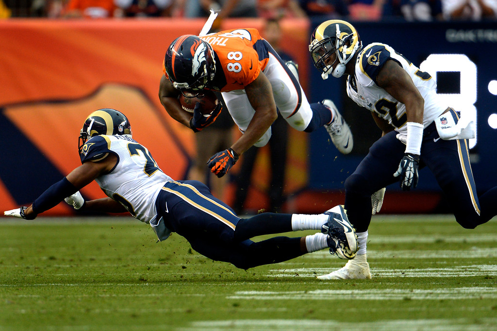 . DENVER, CO. - August 24: The wide receiver Demaryius Thomas (88) of the Denver Broncos is up ended in the first half vs the St. Louis Rams during the 3rd pre-season game of the season at Sports Authority Field at Mile High. August 24, 2013 Denver, Colorado. (Photo By Joe Amon/The Denver Post)