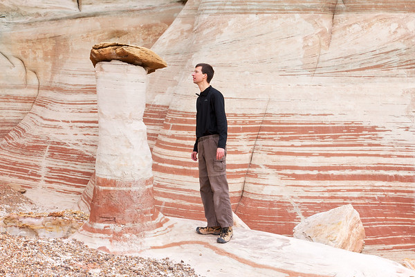 Gordon Smith inspecting a hoodoo in remote Sidestep Canyon.  Getting here requires a long drive through remote southern Utah and then scrambling through a primitive, undiscovered wilderness
