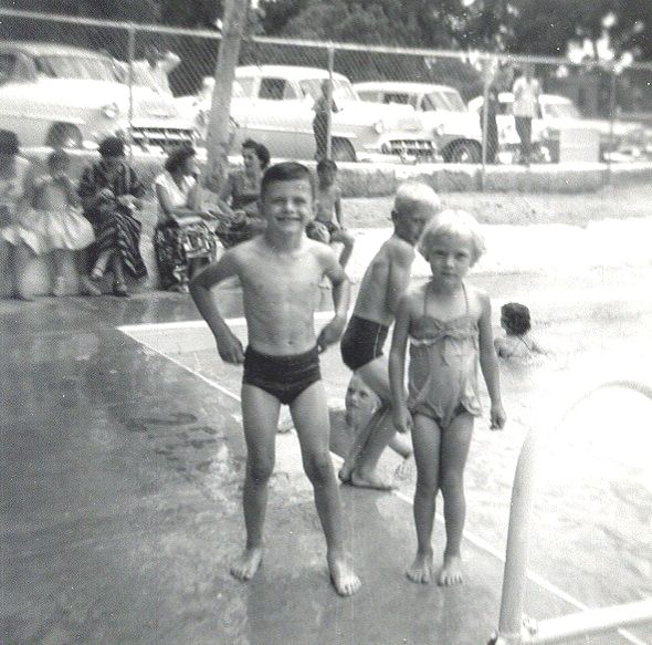 MARY AND ME Lampasas Pool, Lampasas, Texas - 1958  Well, as we're at a family reunion, there are other family members around us, also, such as her brother, David, right behind her and several other cousins and aunts in the background. Isn't she cute -- and doesn't she look cold? She ought to, as the Lampasas Pool is spring-fed with frigid spring water, somewhere in the neighborhood of 60º, I imagine. BRRR!!! It makes me cold just thinking about it.