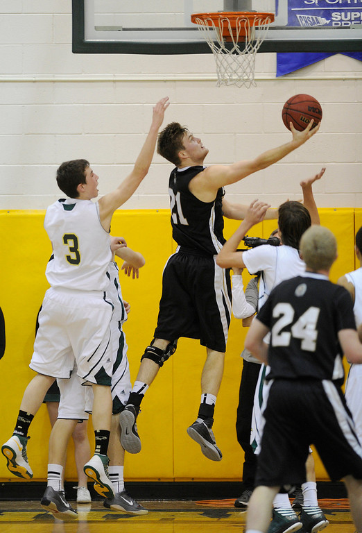 . Warriors senior post Mitch Albyn (21) found a path to the  basket in the first half. The Mountain Vista High School boy\'s basketball team hosted Arapahoe Friday night January 4, 2013.  Karl Gehring/The Denver Post