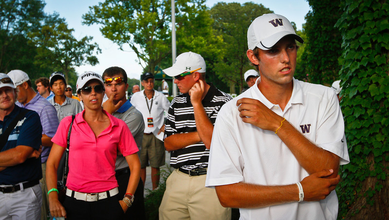 (Right) Chris Williams, 20, of Moscow, Idaho, waits to accept award as the low medalist for the Stroke Play portion of the tournament.