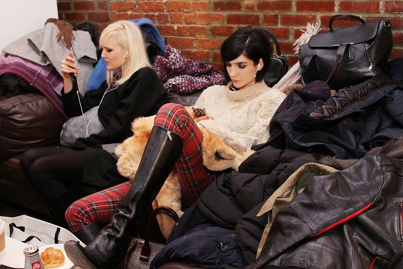 . Models relax backstage at the Peter Som MADE Fashion Week Fall 2014 at Milk Studios on February 7, 2014 in New York City.  (Photo by Mireya Acierto/Getty Images)