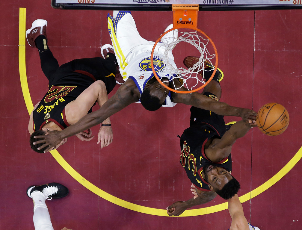 . Cleveland Cavaliers\' Jeff Green has his shot blocked by Golden State Warriors\' Draymond Green during the first half of Game 4 of basketball\'s NBA Finals, Friday, June 8, 2018, in Cleveland. (AP Photo/Carlos Osorio, Pool)