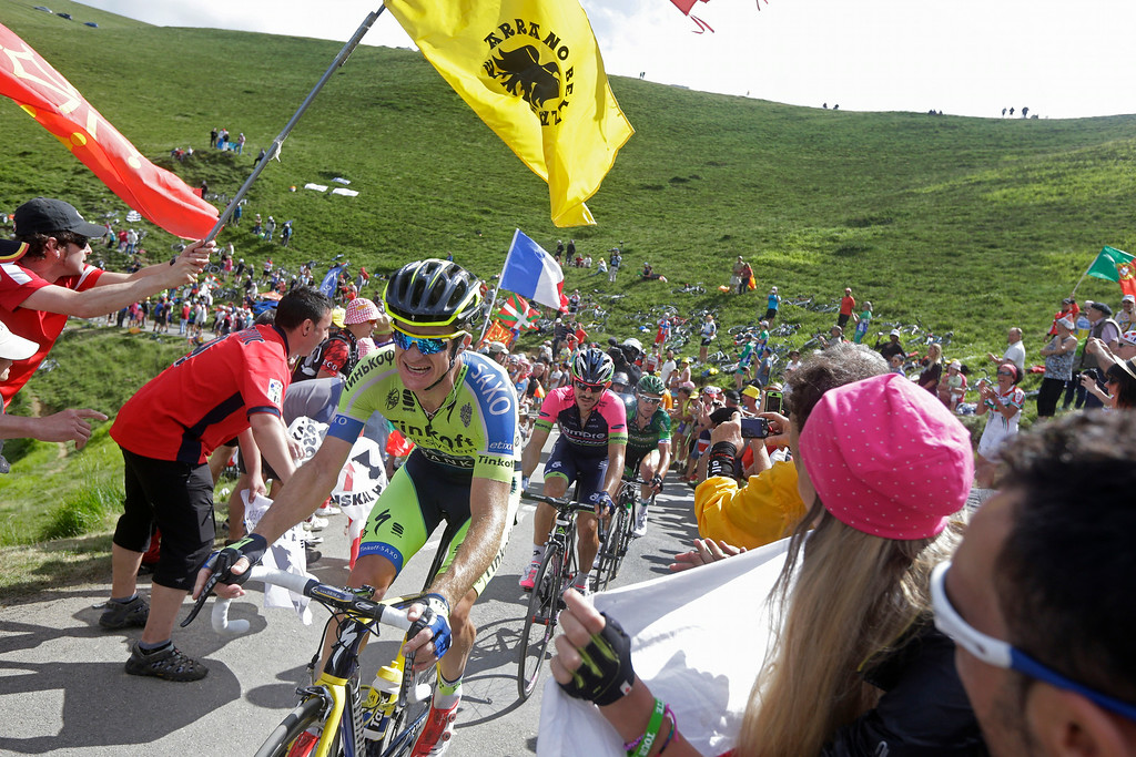 . Stage winner Australia\'s Michael Rogers, front, is followed by fourth place Colombia\'s Jose Rodolfo Serpa, and second place France\'s Thomas Voeckler as they climb Port de Bales pass, Pyrenees region, during the sixteenth stage of the Tour de France cycling race over 237.5 kilometers (147.6 miles) with start in Carcassonne and finish in Bagneres-de-Luchon, France, Tuesday, July 22, 2014. (AP Photo/Laurent Cipriani)