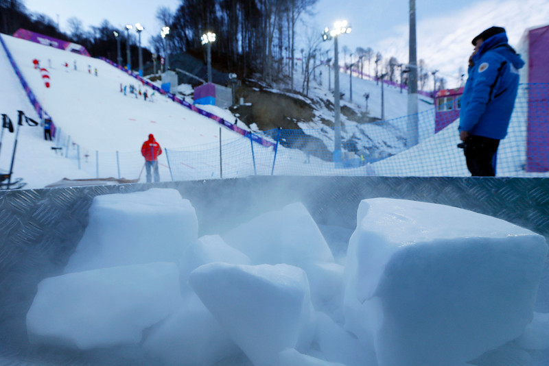 . Dry ice is prepared for use on the surface of the jumps bedore the start of the women\'s freestyle skiing aerials qualifying at the Rosa Khutor Extreme Park, at the 2014 Winter Olympics, Friday, Feb. 14, 2014, in Krasnaya Polyana, Russia. (AP Photo/Sergei Grits)