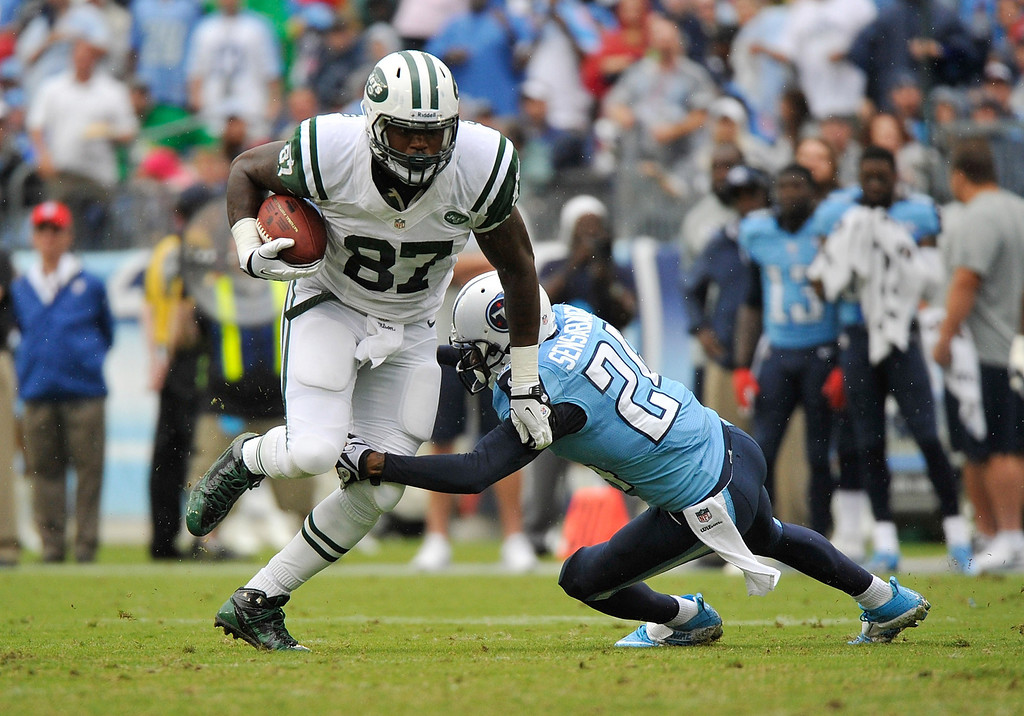 . NASHVILLE, TN - SEPTEMBER 29:  Jeff Cumberland #87 of the New York Jets is tackled by Coty Sensabaugh #24 of the Tennessee Titans at LP Field on September 29, 2013 in Nashville, Tennessee.  (Photo by Frederick Breedon/Getty Images)