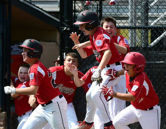 8/10/2018 Mike Orazzi | Staff Rhode Island's Dylan Mourao (9) after scoring the game winning run in the bottom of the 6th during the Eastern Regional Little League Tournament at Breen Field in Bristol Friday.