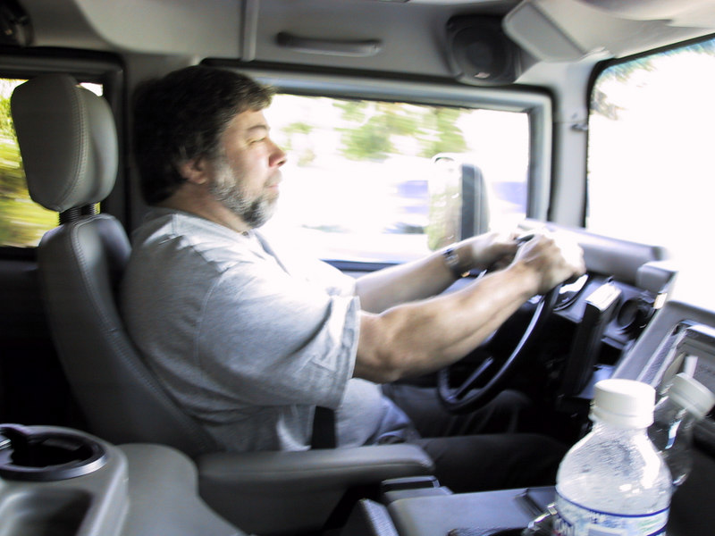 This is The Woz (Steve Wozniak) driving in his silver Hummer.  I stayed at his house after he took me to a concert to see Crosby, Stills, Nash & Young + many others.  We were going to breakfast when I took this pic.