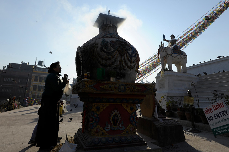 . A Buddhist devotee burns incense at the Boudhanath Stupa - close to where a monk self-immolated against Chinese rule in Tibet - on the third day of Losar, the Tibetan new year, in Kathmandu on February 13, 2013. A Tibetan monk doused himself in petrol in a Kathmandu restaurant on Wednesday and set himself on fire, marking the 100th self-immolation bid in a wave of protests against Chinese rule since 2009. PRAKASH MATHEMA/AFP/Getty Images