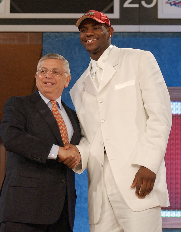 . NBA Commissioner David Stern, left, congratulates LeBron James  after he was chosen by the Cleveland Cavaliers as the overall  first pick of the 2003 NBA Draft Thursday, June 26, 2003 in New York. (AP Photo/Ed Betz)