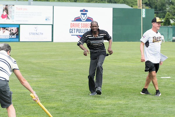 07/02/19 Wesley Bunnell | Staff The New Britain Bees welcomed group home members to New Britain Stadium as part of the Beautiful Lives Project on Tuesday July 2, 2019.Bees players and coaches played wiffle ball games on the outfield grass with the participants. Wilbur Frazier from CCARC runs home from third base to score a run.