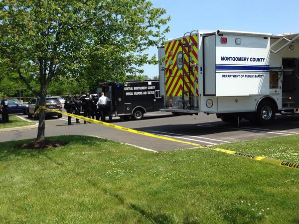 . Police tactical teams converge on Montgomery Township, Montgomery County, Pa., after a report of a shooting.