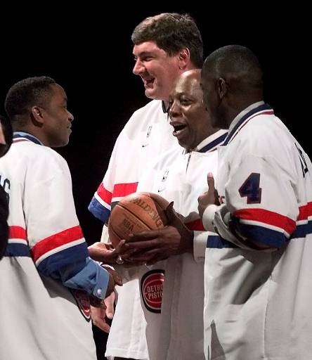 . Former Detroit Pistons\' Isiah Thomas, from left, Bill Laimbeer, Vinnie Johnson and Joe Dumars chat on the court during a halftime ceremony to celebrate the 10th anniversary of their second NBA championship Saturday, March 11, 2000, in Auburn Hills, Mich. Johnson hit a last second shot in game five to beat the Portland Trail Blazers and win the championship. (AP Photo/Duane Burleson)