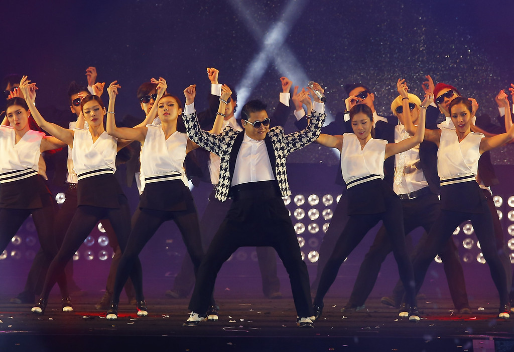 """. SEOUL, SOUTH KOREA - APRIL 13:  Singer PSY performs his new single \'Gentleman\' in concert titled \""""Happening\"""" at Olympic Stadium on April 13, 2013 in Seoul, South Korea.  (Photo by Chung Sung-Jun/Getty Images)"""