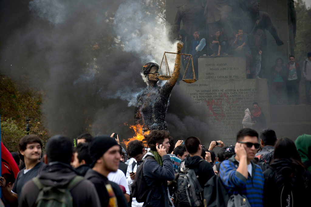 . Students burn an efigy representing the Justice during a protest to demand Chilean President Sebastian Pinera\'s government to improve the public education quality, in Santiago, on April 11,2013. MARTIN BERNETTI/AFP/Getty Images